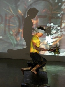 Filipino Filmmaker, Auraeus Solito, attempts to perform a traditional Palawan dance to the music of Diwa de Leon and the video collage prepared by the Japanese artists during the ZENSORS Professional Artist Laboratory. Photo: Rishab Tibon