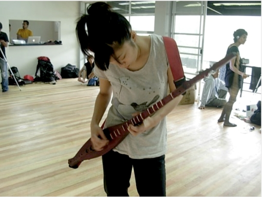 Japanese choreographer/dancer, Chiyo Ogino checks out Diwa de Leon's Hegalong, a traditional two-stringed Filipino instrument. Photo: Rishab Tibon